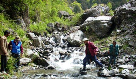 Crossing a rivulet in the Tirthan Valley of GHNP
