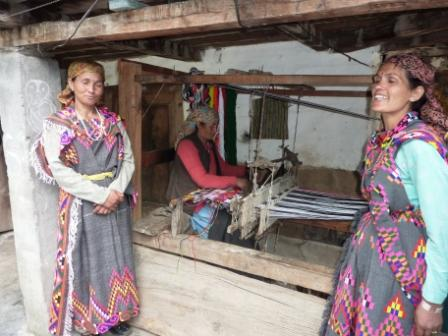 Traditional looms are usually placed outside a village home as is seen here in Tirthan Valley.