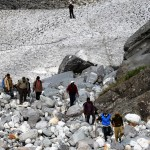 A Trek in Progress over a Snow Bridge in Tirthan Valley (about 3,500)